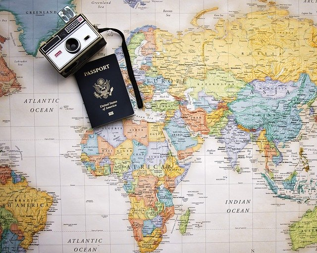 Passport photo with world map and camera
